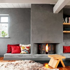 Concrete fireplace and a stool
