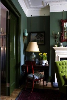 dark green walls with lime green tufted chair & great fireplace. I just don't like that the doors are painted a totally different green; it's too much!