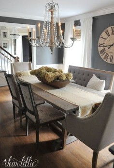Unexpected seating like this bench from @HomeGoods help add character to this dark gray dining room and dried hydrangeas add a soft subtle touch in September. (sponsored pin)