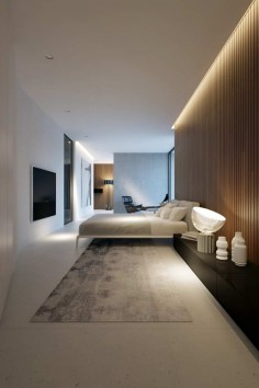 Wooden paneling and lighting gives bedroom depth and dimension