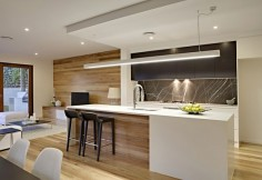A kalka kitchen / living area. Northern Beech timber flooring, Pietra Grey Marble splashback, Quantum Quartz Alpine White island bench stone. Small lot home, Paddington, Brisbane