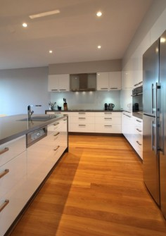 White cupboards, grey top, blackbutt floors